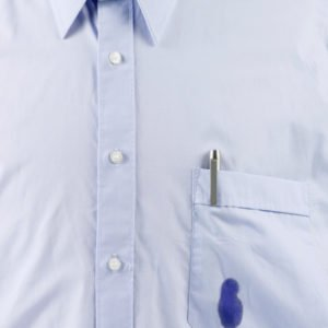 Close-up of blue shirt with ink stain on pocket